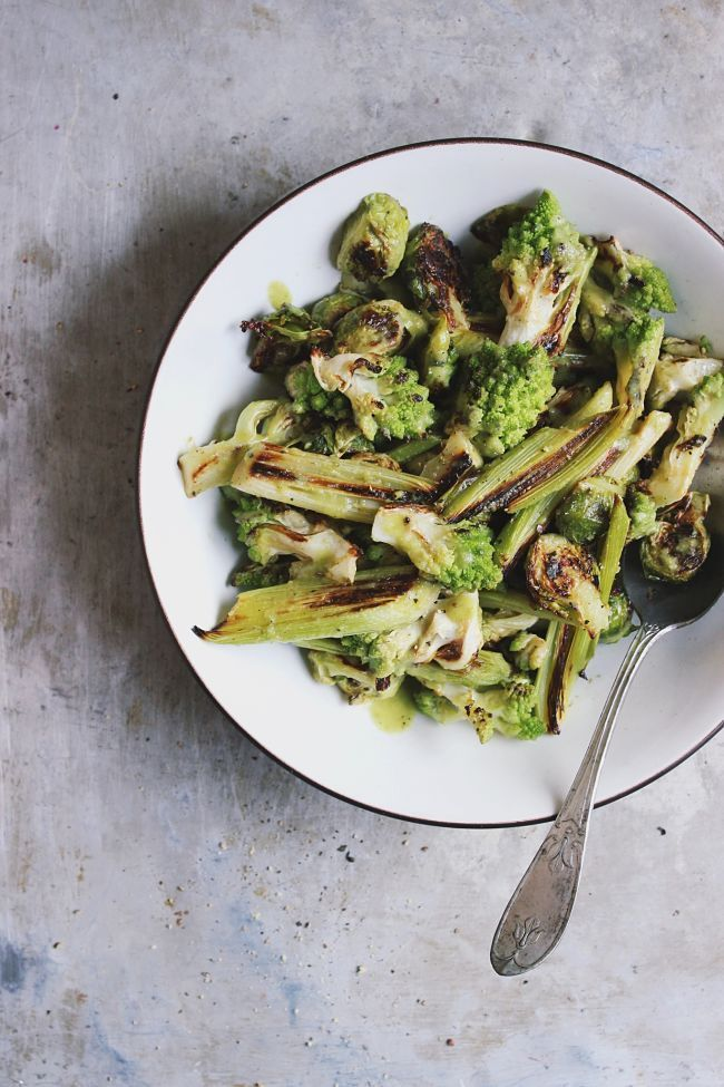 Roasted romanesco leek and brussel sprout salad with green olive dressing, naturally gluten-free and vegan and delicious served warm or cold.