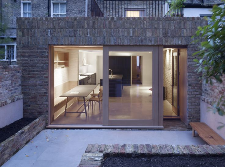 The rear wall is designed with both a sliding door and recessed single glass door that offers an alternative entry to the garden.