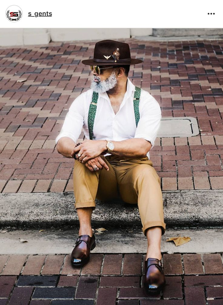 Southern Gents hat with feather polka dot suspenders dress shirt and khaki pants