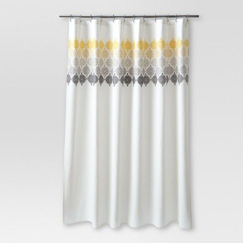 Bring a subtle pop of color to your bathroom with this Ombre Medallion Shower Curtain from Threshold™. The cream shower curtain is made of 100% cotton so you know it's made from the very best. An ombre medallion print along the top fades from yellow to gray to black for a fun accent to your bathroom decor.