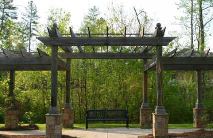 Two Tiered Pergola Along A Walkway For The Home