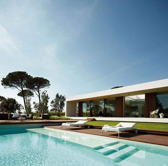 Modern Villa Indigo is designed by Catalan studio Josep Camps and Olga Felip and it is located in the residential area of La Selva at PGA Catalonia