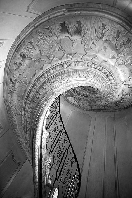 not necessarily paster on the underside of the staircase but maybe fresco...