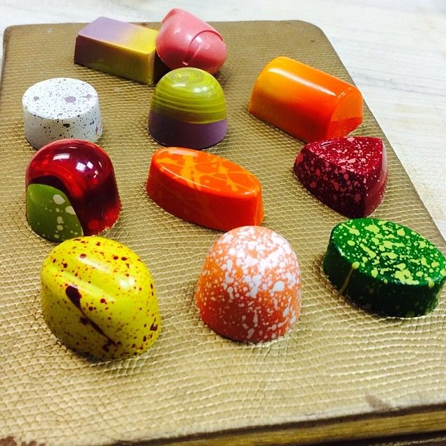 #Bonbons by Bachour. To make your own chocolate candy  & use cocoa butter for similar effects, go to: http://www.chocoley.com/list/colorful-cocoa-butter. Chocoley.com has everything needed for chocolate creations -  gourmet couverture chocolate & gourmet compound chocolate, and gourmet caramel & cream centers. PLUS molds, tools, equipment & supplies for chocolate candy making.