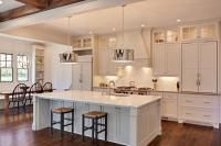 The kitchen and breakfast area.  All the cabinets were custom designed and painted to match the trim in the house.  The marble counters and backsplash counter the commercial appliances and custom light fixtures for an elegant balance.