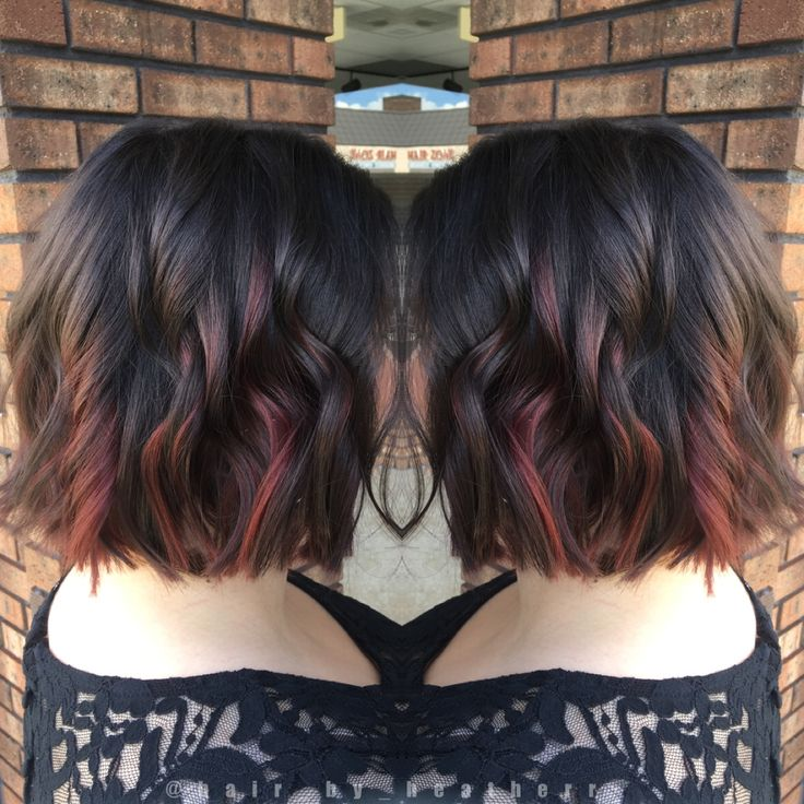 Dark chocolate brown with red peekaboo balayage highlights