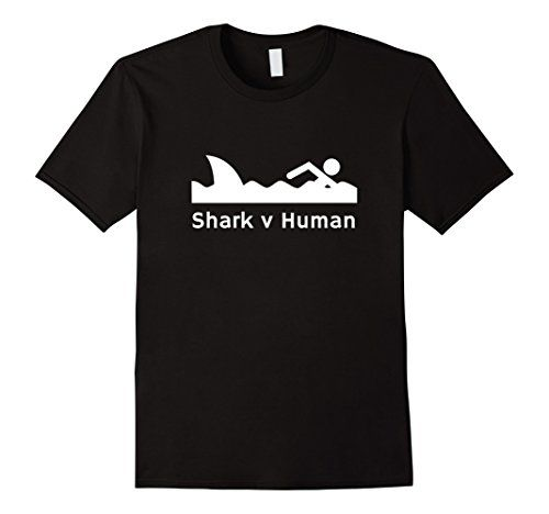 "Shark V Human 2017 Novelty Graphic T-Shirt Shark versus the fastest man alive in the water. Discovery channel Shark Week Michael Phelps vs shark who is faster. This ""Shark v Human"" shirt makes an awesome gift for the shark lover in your life. Perfect for anyone who loves TV shows about sharks. Available in 5 colors from Amazon."