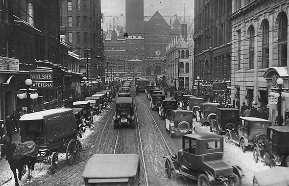 This picture shows the Bay Street traffic, Toronto, 1920. We can see lots of cars on the street and it is pretty fansy