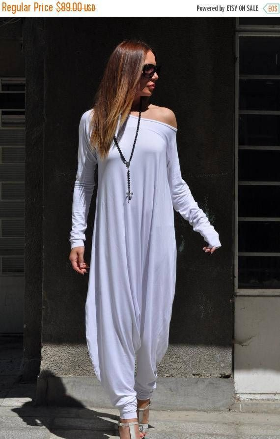 f9d226c44d7 Product Description  This fabulous white loose maxi jumpsuit for women is a  new must-have garment for the summer. This cotton jumpsuit is available in  both ...