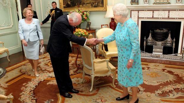 The Queen greets former Australian prime minister John Howard.