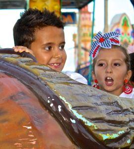 Enjoying the amusement rides at the Feria de Nerja