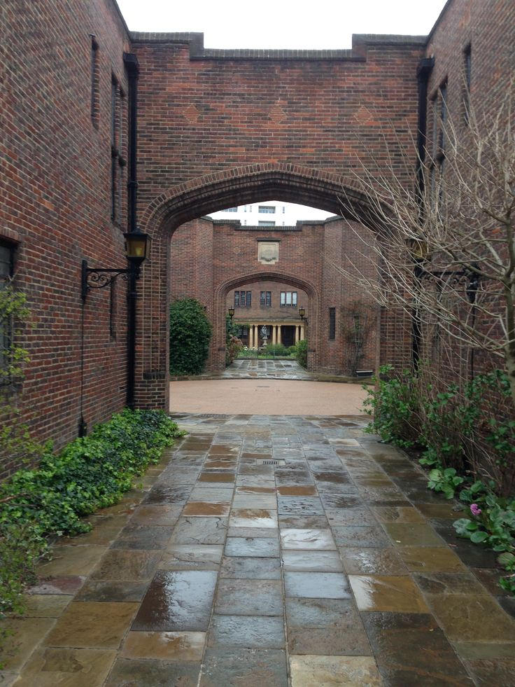 Arched passageways into courtyards at Whitehead Grove, Kensington, London