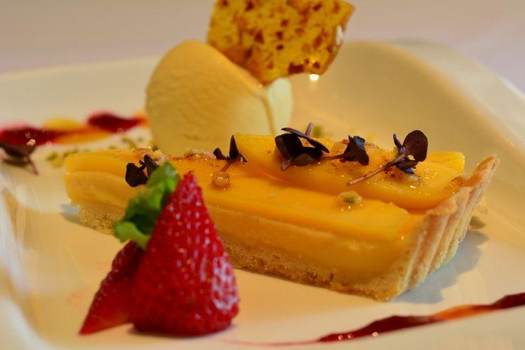 Lemon Grass and Mango Tart       With leatherwood forest honey ice-cream and almond praline