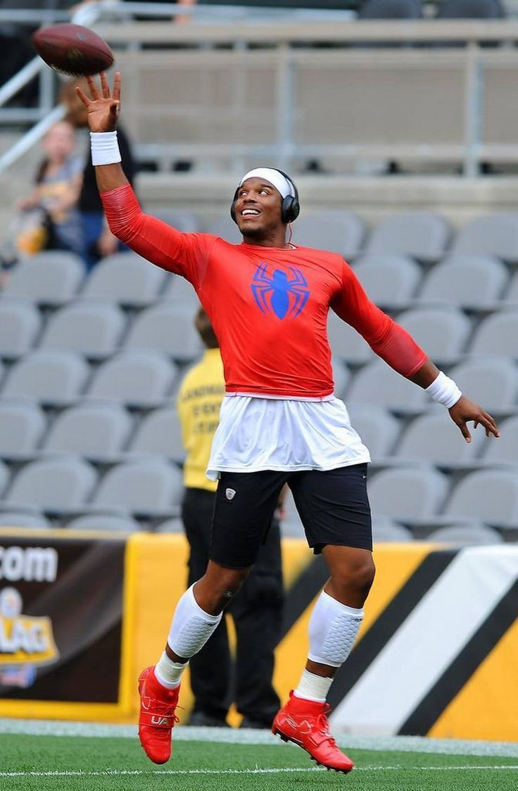 Carolina Panthers quarterback Cam Newton smiles as he leaps to catch a football one handed during a warmup at Heinz Field in Pittsburgh, PA. prior to the team's preseason game on Thursday, September 3, 2015.