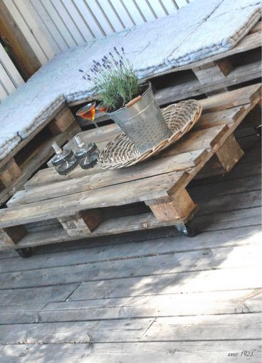 Pallet table on wheels. Perfect for food and drinks and a good book or two.