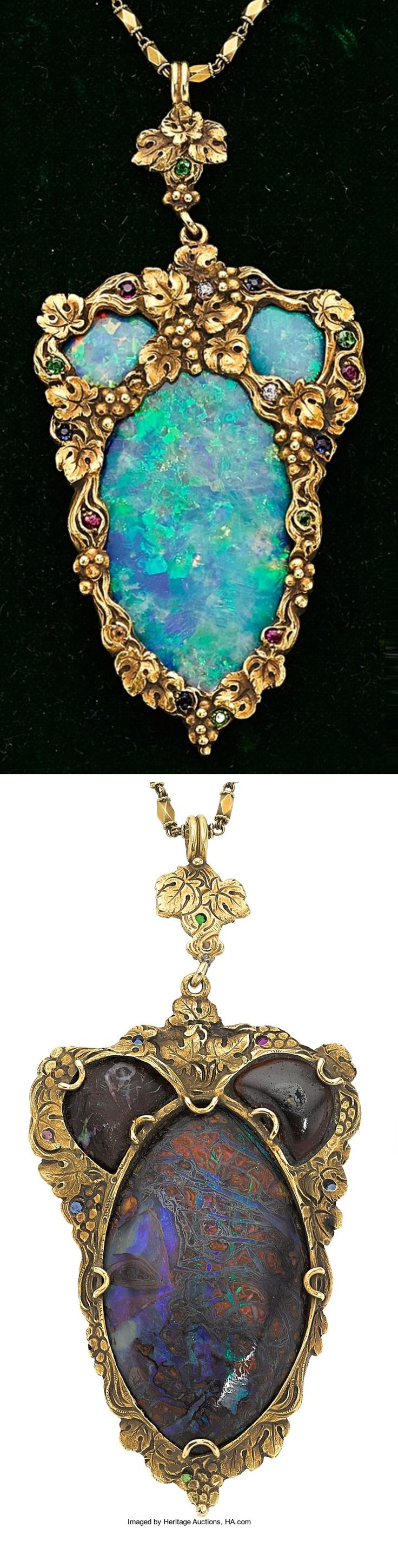 F. Walter Lawrence - An Arts and Crafts gold, boulder opal, diamond and gem-set pendant necklace. The pendant features an oval-shaped boulder opal, surmounted by two smaller boulder opals, enhanced by round-cut demantoid garnets, sapphires, rubies, citrines and pink tourmalines, accented by one pink and one near colourless diamond, set in 18k gold. 3-1/4 x 1-1/2 inches. #FWalterLawrence #ArtsAndCrafts