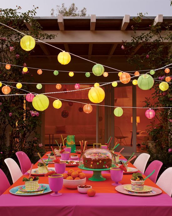 Colored lanterns for alfresco summer parties. via http://www.pinterest.com/pin/21181060722388413/ ~ Afloral.com has a vast array of lanterns to provide beautiful and fun lighting for your party