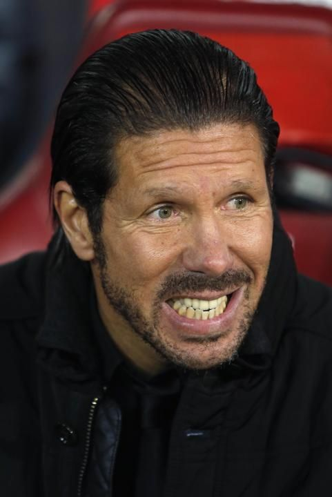 Atletico's coach Diego Simeone gestures during a Spanish La Liga soccer match between Atletico de Madrid and FC Barcelona at the Vicente...
