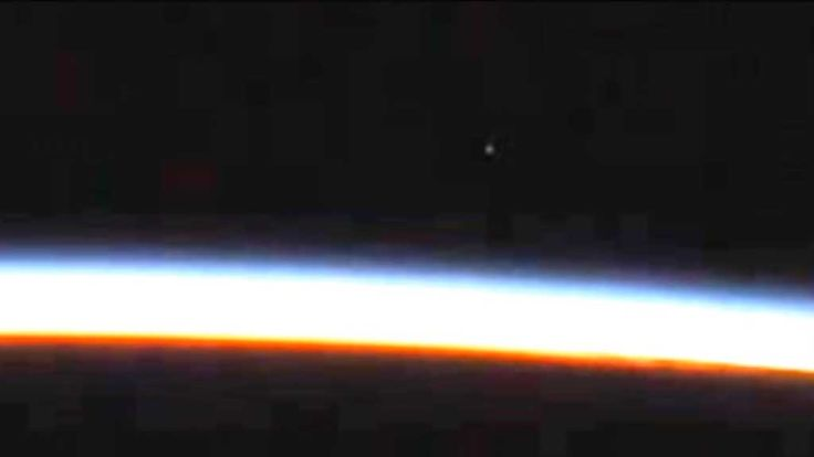 UFO believers are accusing NASA of cutting the International Space Station's live feed to cover up a mysterious object entering the Earth's atmosphere.