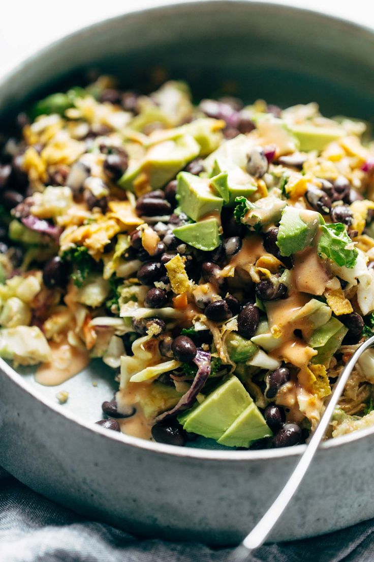 Cheater's Power Salad - kale, cabbage, avocado, green onion, cilantro, black beans, crispy onions, tortilla strips, chicken, and BBQ ranch dressing, made from a salad mix! I KNOW. perfect for easy lunches!   pinchofyum.com