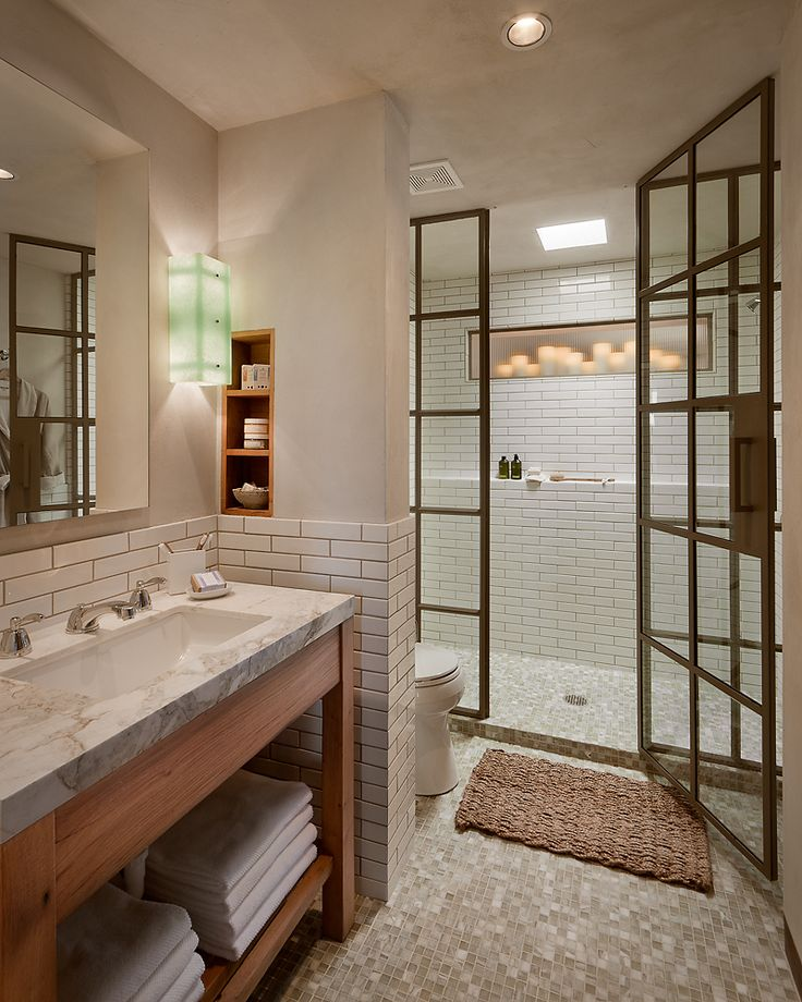 Such a beautiful bathroom with a glass shower stall (Designed by Desert Star Construction) | Friday Favorites Bathroom at www.andersonandgrant.com