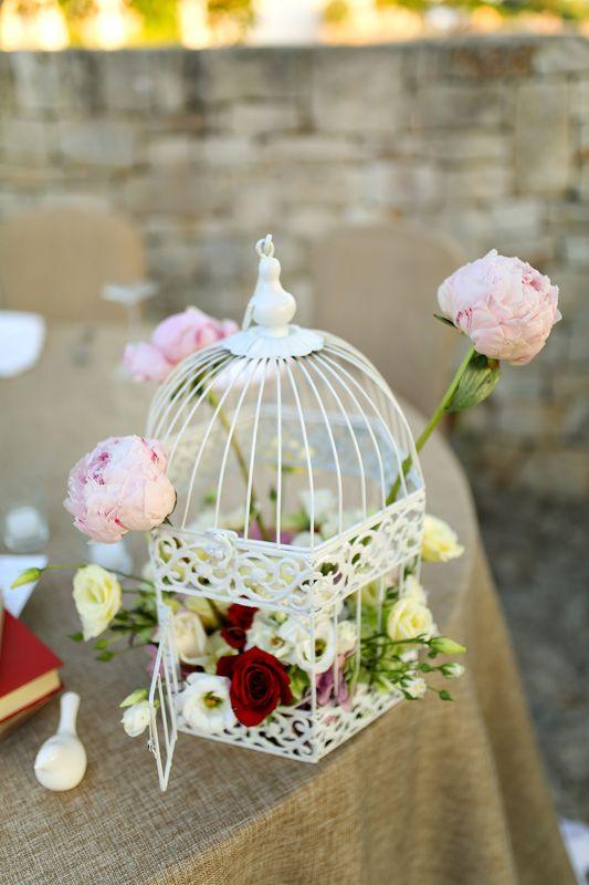 Groom and bride table decoration element: white cage with flowers / Элемент декорации стола молодоженов: белая клетка с цветами