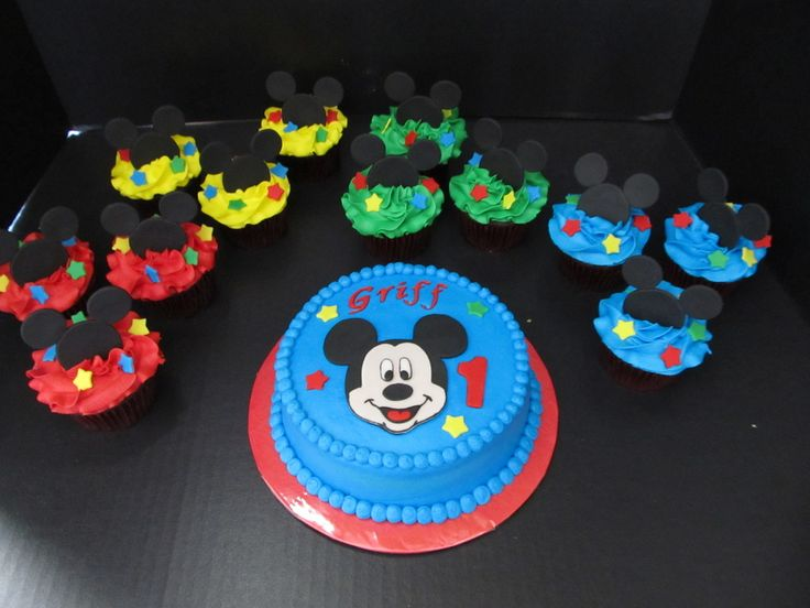 Mickey mouse cupcakes, frosting in primary colors with fondant mickey heads and stars, matching smash cake with fondant Mickey face, stars, name and number, all made for a little boys 1st birthday!