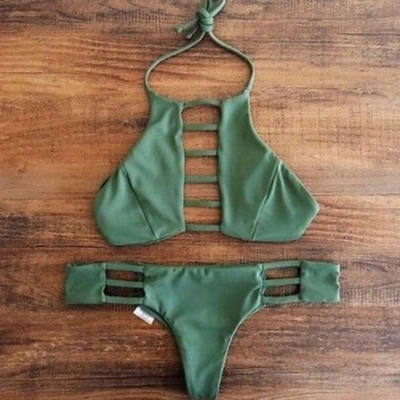 """Strappy Green Bikini New cheeky bikini. Padded w/ hook closure and tie neck. I'm a B cup/size 28 wearing M. See pictures 2 & 3 for actual item.  DETERMINE IF IT WILL FIT YOU:  L: top - 14"""" width 7.5"""" cup length; bottom - 15"""" waist 8"""" rise 9.5"""" leg opening  DON'T BUY THIS LISTING!!! Comment the size  Please ask questions before purchasing. SALES ARE FINAL BUNDLE DISCOUNT ▪️NO TRADES OR HOLDS ▪️FIRM PRICE Swim Bikinis"""