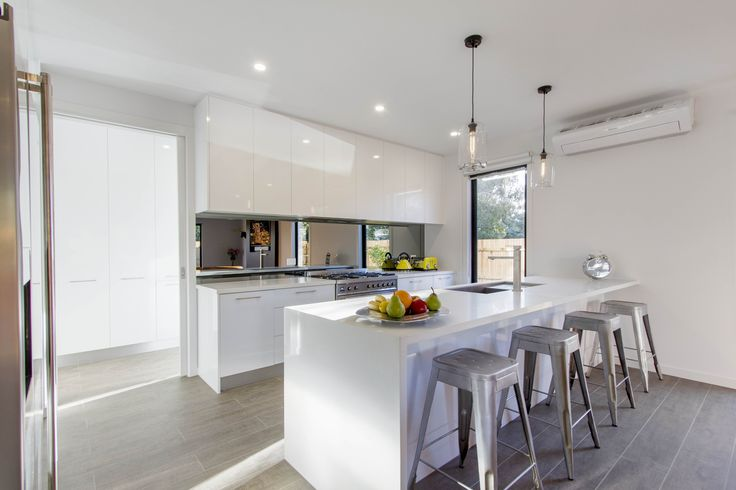 white kitchen and breakfast bar