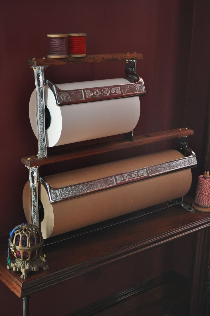 Wish I had a spot for this in my home. Would be great in a craft room. Vintage paper cutters and the twine (yarn) holder.