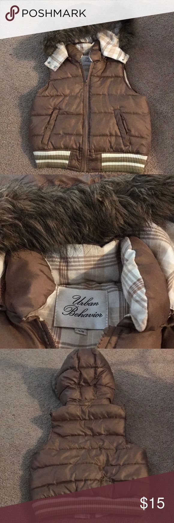 Urban Behavior Fashion Vest Very cute vest from Urban Behavior. It is a youth large, but fits a women's xsmall/Small. It has little signs of use and no flaws. Faux fur on the hood of the vest. Very warm and fashionable. It's a light brown color Urban Behavior Jackets & Coats Vests