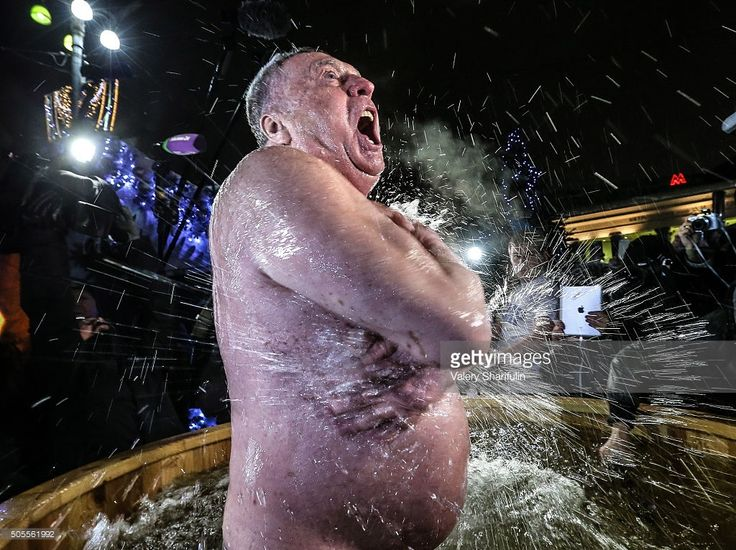 MOSCOW, RUSSIA. JANUARY 18, 2016. Russian Liberal Democratic Party Leader Vladimir Zhirinovsky takes a dip in a basin with cold water during celebrations of Orthodox Epiphany in Revolution Square. In Eastern Christianity, the feast of Epiphany commemorates the Baptism of Jesus. The Russian Orthodox Church celebrates the holiday according to the Julian calendar. Valery Sharifulin/TASS