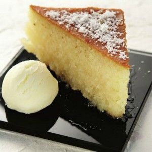 Syrupy cake with homemade ice cream (ravani)