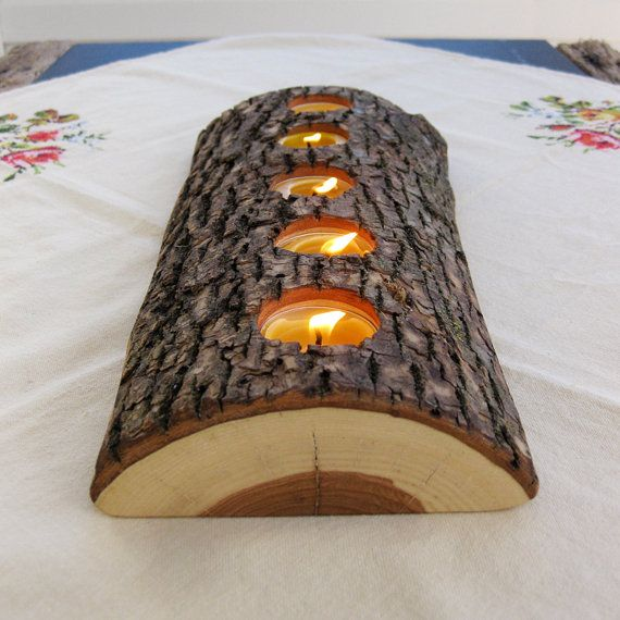 DIY tealight wood candle holder. I did this with a short log that had Not been sliced ~ this flat side will be so much better next time! Use a paddle bit on a drill to make the holes for the candles.