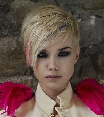 A short blonde straight side parting hairstyle by Burlesque