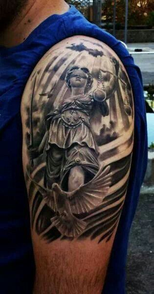 Oh wow, an actual blind justice tattoo - not bad - it's even in the right place to be on Laz's arm.