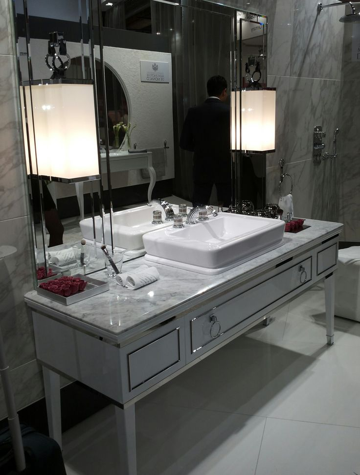 Lutetia vanity unit in white finish with chrome trims, with a beautiful top in Carrara marble. Designed by Massimiliano Raggi