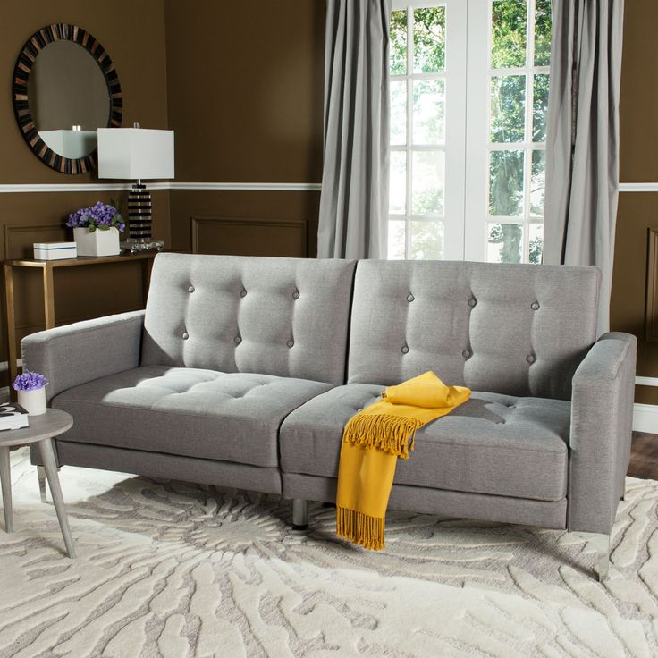 The Safavieh Soho grey sofa bed, LVS2000B, is a functional love seat & foldable bed upholstered in chic grey fabric for metro-styled furnishings.