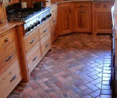 richmond red brick kitchen flooring tiles. Like the edging to transition to wood in another room.