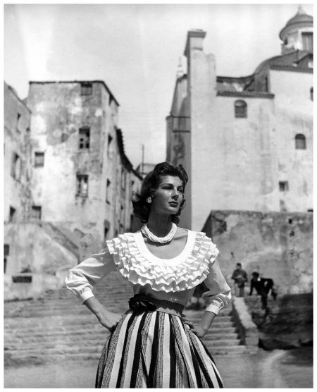 Fiona Campbell-Walter in skirt and ruffled blouse by Christian Dior, Corsica, photo by Georges Dambier, Nouveau Femina, June1954