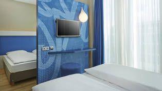Moderne Doppelzimmer im H2 Hotel München