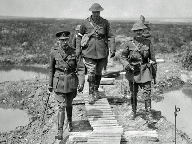 Canadian commander General Arthur Currie, centre, walks along Vimy Ridge with King George V, left.