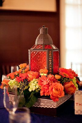 Colored lanterns, wooden boxes, florals, and lace were combined to get the perfect look