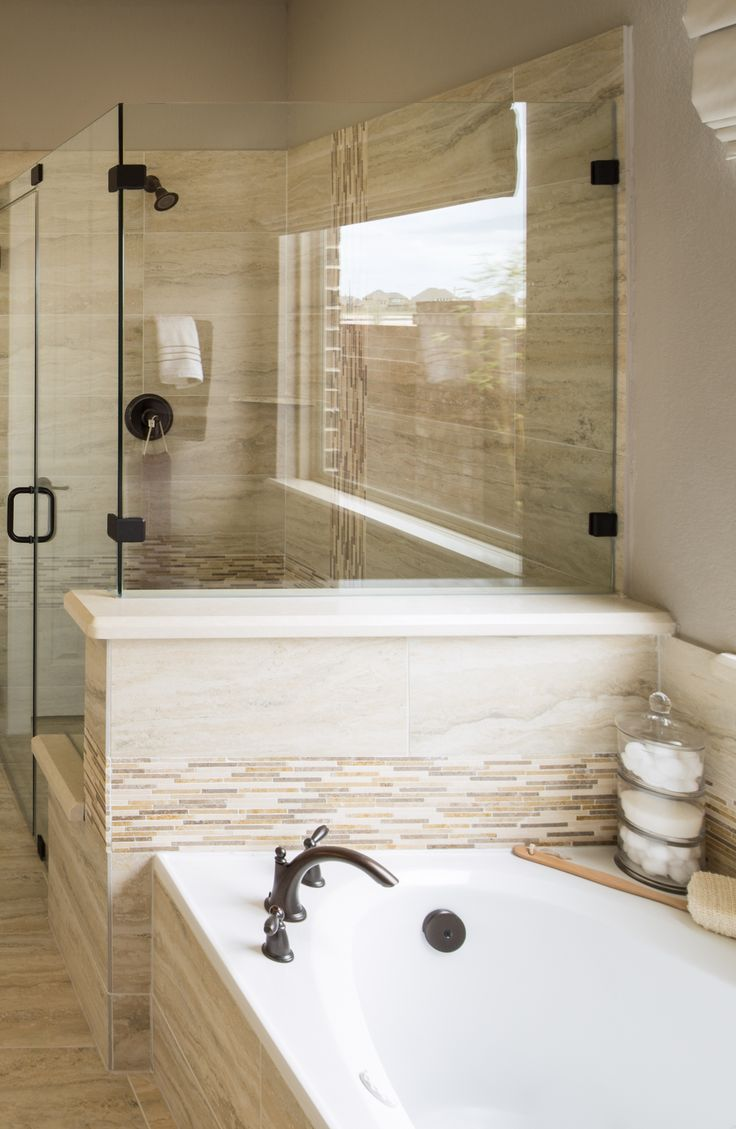 Bronzed Faucets Add A Complimentary Aesthetic To Naturally Colored Master Bathroom Seen In Cypress