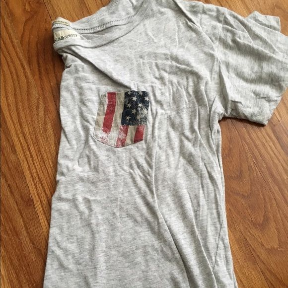 Ralph Lauren Short Sleeve American Flag Pocket Grey short sleeve, soft material. Sort of shorter- if you are really tall it would possibly be like a crop top. Vintage American flag pocket. Ralph Lauren Tops Tees - Short Sleeve