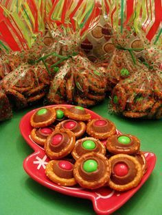 Christmas buttons: Rolo pretzel bites (300degrees/circle pretzels on parchment/rolo in each/bake 3-5min/ remove & put m on each)