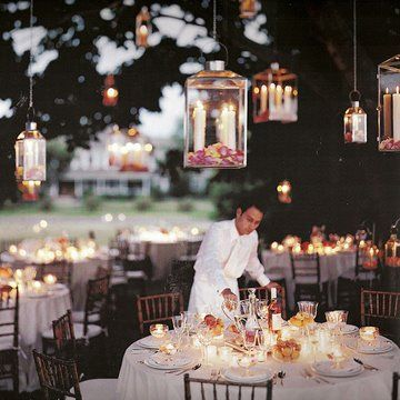 Hanging lanterns - I LOVE THIS idea of having a reception under a big tree's canopy or group of trees! Or recreate this in a tent!