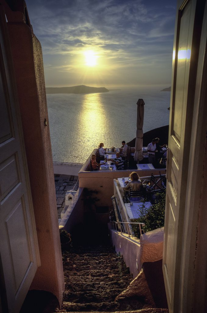 Sunset dining in Fira town, Santorini island, Greece. - selected by www.oiamansion.com