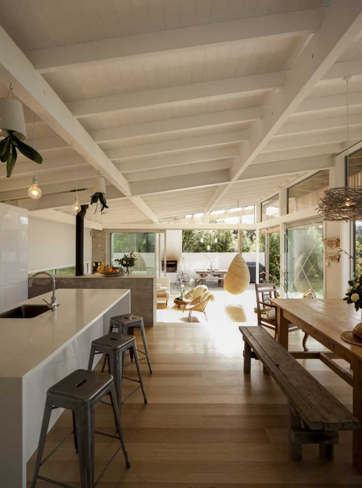 Can't beat a white exposed timber raking ceiling, especially with rustic timber furniture and raw concrete finishes.