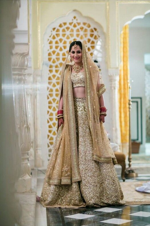 Shimmering gold lehenga. Indian bride